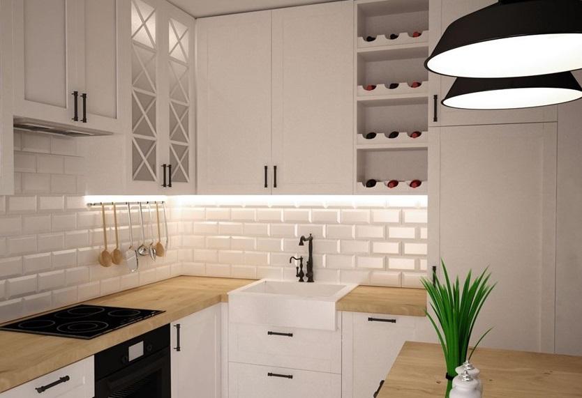 mała kuchnia urządzona w białej aranżacji ze smakiem